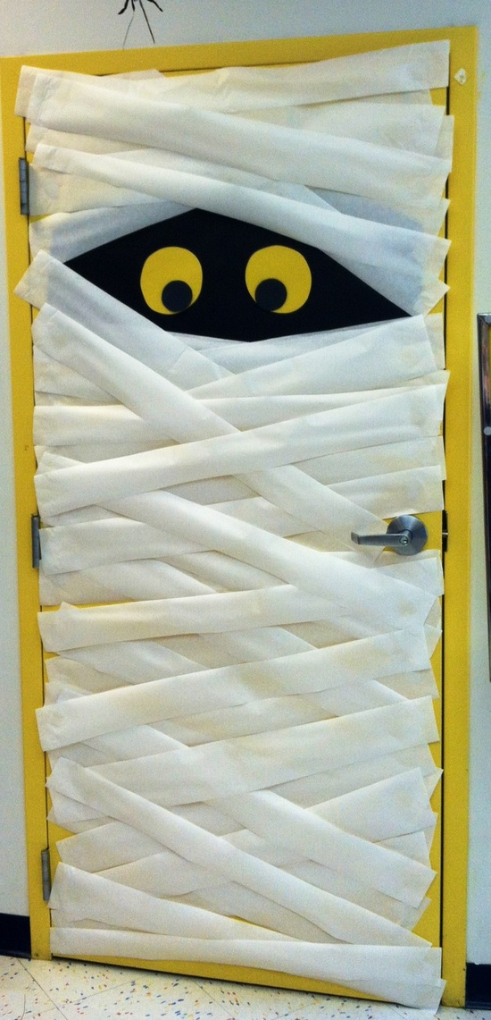 Cool halloween door decorations you can do with your kids for Cool door ideas